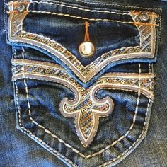 """NWT Rock Revival """"Stephanie"""" dk blue jeans 27 boot Brand new with tags Beautiful Rock revival """"Stephanie"""" boot cut size 27 ladies jeans. Inseam 32 Swarovski crystal accents over flap pockets with leather piping and blue and gold sequence accents. Extra thick thread. 2% spandex 98% cotton. Absolutely a head turner Rock Revival Jeans Boot Cut"""