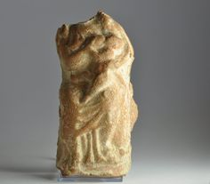 Roman pottery statuette depicting mother nursing her child, 1st century A.D. Draped woman nursing her child, head of the woman missing, 10.3 cm high. Private collection