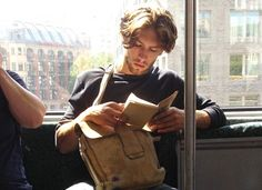 Start following @hotdudesreading. The brand-new and brilliantly captioned Instagram account captures gorgeous, unsuspecting dudes getting lost in literature. Swoon.