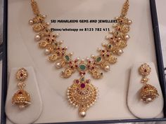 Get the best designs specially added f season. Presenting here is a Uncut Diamonds Mango necklace with Jhumke. Visit for full variety at sravanam offers. Call on 8125 782 411 for orders. Gold Earrings Designs, Gold Jewellery Design, Necklace Designs, Gold Necklace Simple, Gold Jewelry Simple, Short Necklace, Bridal Jewelry Sets, Bridal Jewellery, Vintage Jewellery