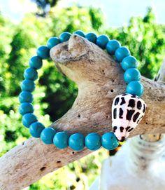 Turquoise and Seashell Bracelet.  Hawaii Cone Shell and Turquoise Beaded Bracelet. Casual Beach Stretch Bracelet with Shell.  Hawaiian Style by KailuaKai on Etsy https://www.etsy.com/listing/253219148/turquoise-and-seashell-bracelet-hawaii