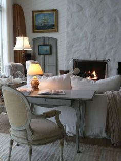 From Velvet & Linen  Fireplace's lava stone was plastered over to achieve the look.