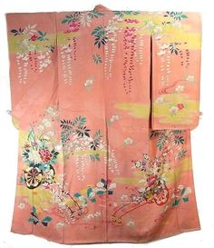 This is a fabulous pink kimono from around Taisho Period(1912-1926).  Flowers cart, wisteria and cherry blossom motifs are dyed colorfully with yellow mist pattern.  In the left front and shoulder, gorgeous embroidery is added.  Textile is silk with damask effect(rinzu), and has soft and smooth touch.  Lapel is bachi-eri(folded lapel).