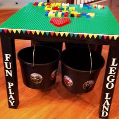 Lego table (end table with green Lego plates glued to the top, hooks screwed underneath to hold buckets for Lego storage)