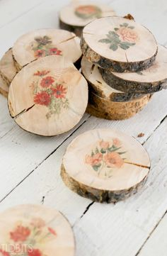 Wooden Botanical Coasters: These beautiful slices of wood have been transformed into charming coasters, and all it took was a roll of wax paper and an inkjet printer.