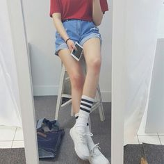 Red tshirt, high waisted cutoff shorts and sporty stripped socks.