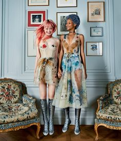In a nod to house founder Christian Dior's mysticism, Chiuri embellished frothy party frocks with tarot-inspired symbols (seen here on the cotton candy–tressed models Fernanda Ly, left, and Lineisy Montero in the salon historique of M. Dior).Background: Christian Bérard © 2016 Artists Rights Society (ARS), New York/ADAGP, Paris