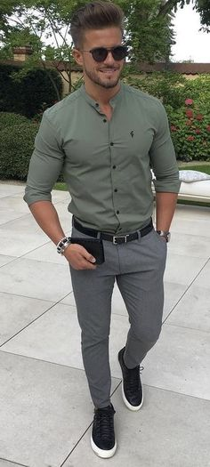 @antonio.pozo - Summer style inspiration with a sunglasses a green banded collar shirt with rolled up sleeves silver watch wrist accessories black leather belt gray trousers no show socks black leather sneakers.   #summerstyle  #summeroutfits #sneakers #menswear #menstyle #mensfashion