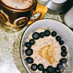 Breakfast this morning!! Basic oats, cinnamon, #bloobs, and some protein hot chocolate  topped with #musclebutter carrot cake flavor  #oatmeal #oats #oatmealporn #blueberries #bloobs #carrotcake #musclebutter #proteinhotchocolate #carbs #protein #fats #fitness #healthy #fitspo #fitspiration #motivation #brekkie #breakfast #yum #food #fitfood #fitfoodie #pescience #foodisfuel