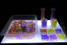 Invitation to play with water beads on the light table
