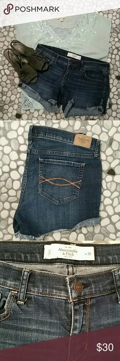 Abercrombie & Fitch jean short Cut off jean short by Abercrombie & Fitch. Dark rinse denim with frayed hems. Waist 30 with 3.5 inch inseam.  ☆Only pay one shipping cost and save 15% off if you bundle with 1 or more other items!!! Abercrombie & Fitch Shorts Jean Shorts