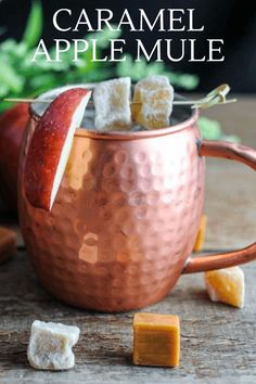 This Caramel Apple Moscow Mule is great for the fall. A fabulous combo  of caramel vodka, lime juice, apple cider and ginger beer! #cocktail  #apple #vodka