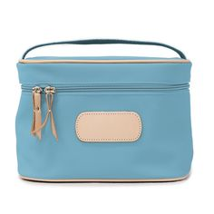 Protect your, arguably, most treasured travel items with this durable makeup case. | Shown in Ocean Blue Coated Canvas