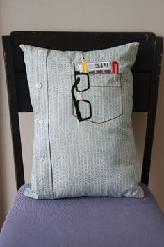 Nerd Pocket Pillow. This could be sewn from an man's shirt. Keep in mind for sewing project