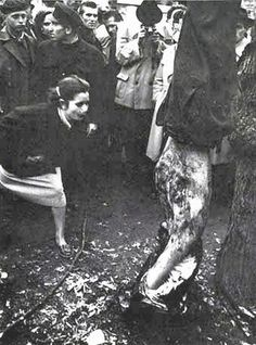 Scornful vengeance is vented by woman who spits at the mangled corpse of a secret police colonel hung head down in Budapest Square of the Republic. Hungarian Women, Virgin Media, Pictures Images, Bing Images, Human Condition, Budapest Hungary, The Republic, Vietnam War, Old Photos