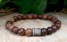 Check out this item in my Etsy shop https://www.etsy.com/listing/252882493/spiritual-mens-mala-bracelet-ebony-wood
