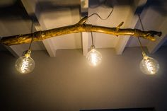 Homemade lamp using wood found in forrest,  wire surrounded with cord and classic copper fittings.