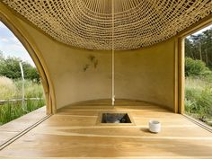 The tea house is constructed of natural and sustainable materials and designed to integrate into the surrounding landscape. The building consists of a sheltered patio area and an inner chamber made from smooth timber.
