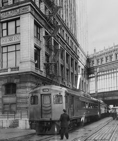 Chicago And North Western Train Alongside Wrigley Building Photograph by Chicago and North Western Historical Society