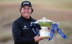 All smiles: Phil Mickelson shows off the Scottish Open trophy after his play-off success.   Phil Mickelson bounced back from scorning a winning chance on what should have been the final hole to win the Aberdeen Asset Management Scottish Open by beating Branden Grace on the first hole of a sudden-death play-off.