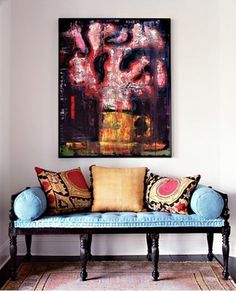 suzani pillows and bright, unexpected colors on traditional furniture