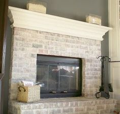 Lime wash / white wash brick, white mantle, grey walls, white trim