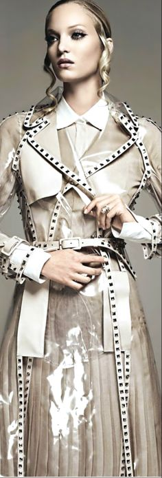 trench style raincoat. featured on Fashion magazine cover. making a stylish coat…
