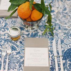Wedding Table, Portofino table linen, white and blue table cloth, oranges as centerpieces, honey wedding favor, grey napkin, printed menu, new blue and white wedding style,