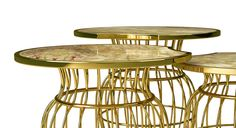 Sienna Table Set - are an #exotic cage of #emotions. The #expressive onyx table top displays a range of earthy #colors, from #gold to ochre or from amber to sienna. Below, the wireframe brass structure is carefully assembled by hand. These design elements capture the #intensity of natural resources, making them the ideal center tables for #organic chic #contemporary living rooms or #lounge areas.