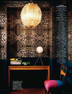 Striking Geometric Wallpaper and Inky Blue Hallway
