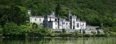Kylemore Castle and Abbey in Connemara, Ireland.  Absolutely beautiful grounds. The gothic church is exquisitely crafted from red, gray and green Irish marble.