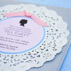 adhere paper invitation to doily and tie with ribbon. by beyonddesign