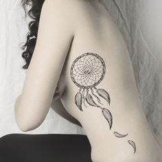 small dreamcatcher tattoo designs on ribs