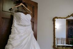 Keep in mind a beautiful hanger can help create a timeless image of your beautiful gown in the bridal dressing suite of the Carriage House, which is furnished with Chiavari chairs and an antique French mirror.