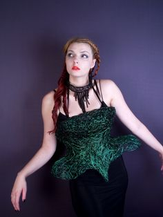 Green wire corset and black wire necklace by Tavia Sanza
