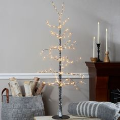 Our frosted holiday tree features long, snow-covered branches wrapped in dewy, warm white LED lights and including twelve beautiful antique mercury glass finial ornaments. Place near the entryway or flanking your mantle for a sparkly, festive ad Twig Christmas Tree, Diy Christmas Lights, Christmas Decor, Holiday Tree, Rustic Christmas, Christmas Holiday, Holiday Decor, Modern Rustic Decor, Eclectic Decor