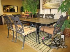 "Frontgate stone top dining table on a dark metal base with six chairs. Two are swivel rockers, the other four are stationary. Love the palm print seat cushions. 84""long x 42""wide. Wonderful buy!"