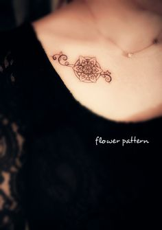 a flower pattern tattoo on the chest #flower #tattoo