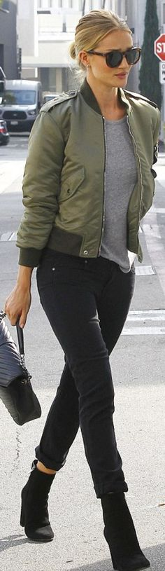 Who made  Rosie Huntington-Whiteley's green jacket, suede boots, brown sunglasses, black skinny jeans, gold jewelry, and quilted handbag?