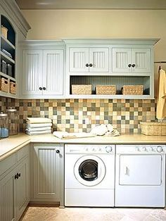 laundry with colored backsplash and bead board cabinets- I would have done in a light green or pale yellor or cream instead of blue