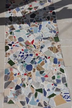 we made this mosaic with broken old tiles, at the home entrance floor.