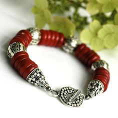 Clever use of the gorgeous red coral and beautiful sterling beadwork. Love it.  Bracelet  Coral discs  Sterling silver by Huismus on Etsy