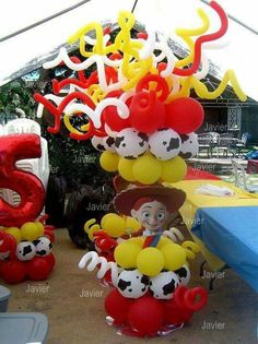 I like the cow print balloons mixed in. also need the skinny ones Toy Story Baby, Toy Story Theme, Toy Story Birthday, Kids Party Decorations, Balloon Decorations, Party Themes, Balloon Ideas, Party Ideas, Cumple Toy Story