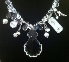 """This is a stunner ! Necklace is made of polished Quartz crystal droplets. Then dangling so sexy is a Vintage Crystal chandelier centerpiece. Mixed in are vintage rhinestones , pearls, handmade pendants with eyes and lips along with a little high heel shoe. Pefect! Necklace total length is 20"""" and can be adjusted down (silver chain)  $165.00"""