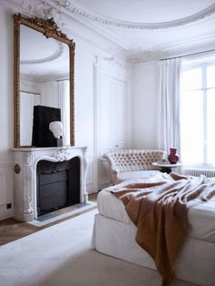 Bedroom with fireplace and oversized mirror