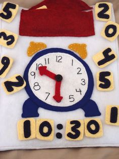 Clock with moveable hands and changeable numbers make with magnets for fridge