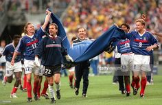 World Cup Final, St, Denis, France, 12th July, 1998, France 3 v Brazil 0, French players Petit (17), Charbonnier (22), Diomede (13) and Guivarc'h parade a large T-shirt on a lap of honour after their historic win