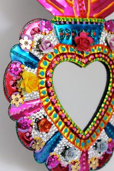 Sacred Heart tin metal mirror / Mexican folk art / bright colorful mixed media / rainbow silver / wedding gift. $38.00, via Etsy.