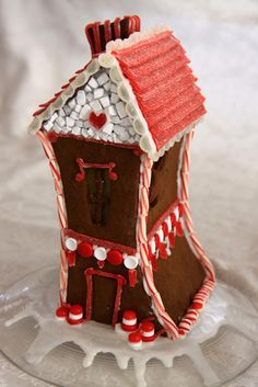 Really cool valentines gingerbread house. Looks like the roof is made of red licorice.