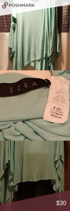Mint Green Poncho Top One size fits most! Perfect trendy poncho top that hides your problem areas! This medium can fit plus sizes well! Super stretchy, comfortable fabric.  Smoke free home. Ezra Tops